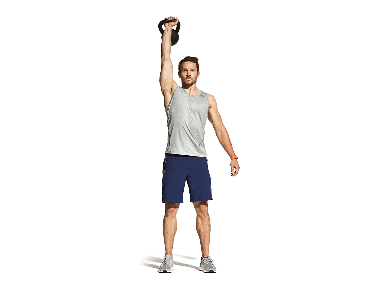 How does the exercise push the kettlebells?