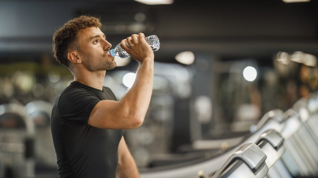 how much water should an athlete drink daily
